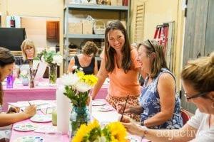 Kara teaching Watercolor class at Adjectives